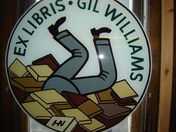 Gil's Book Loft bookstore logo