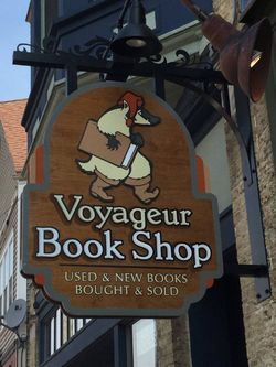 Voyageur Book Shop bookstore logo