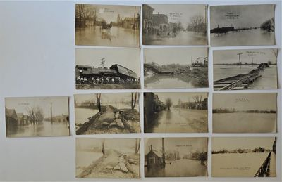 Shelbyville, Indiana: No Publisher, 1913. RARE collection of 13 real photo postcards depicting the h...