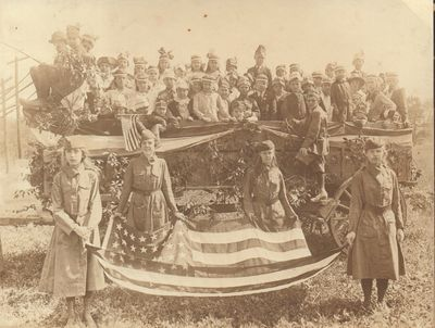 Very Good. Albumen print on mount of the same size, depicting a group of girl scouts and children we...