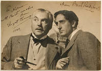 An extremely rare vintage signed and inscribed photograph of both Basil Rathbone and Nigel Bruce individually, the image depicting the two actors in half length poses together in costume as Sherlock Holmes and Dr. Watson in a scene from one of their films. Signed by both in dark fountain pen inks to clear areas above the image, Bruce adding an inscription and the date, 1943, in his hand.