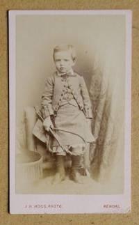 Carte De Visite Photograph: Portrait of a Young Boy Holding a Riding Crop.