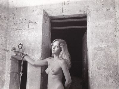 N.p.: N.p., 1974. Vintage borderless reference photograph from the 1974 film, showing actress Marian...