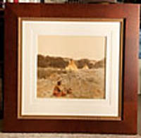 """""""PLENTY BIRD IN HIS SWEAT LODGE."""" 28 3/4"""" x 29 1/2"""" MATTED AND FRAMED ORIGINAL HUFFMAN PHOTOGRAPH, HAND COLORED, TITLED, AND SIGNED BY HUFFMAN IN WHITE INK ON THE SURFACE OF THE PHOTOGRAPH AFTER THE COLORING WAS COMPLETED"""