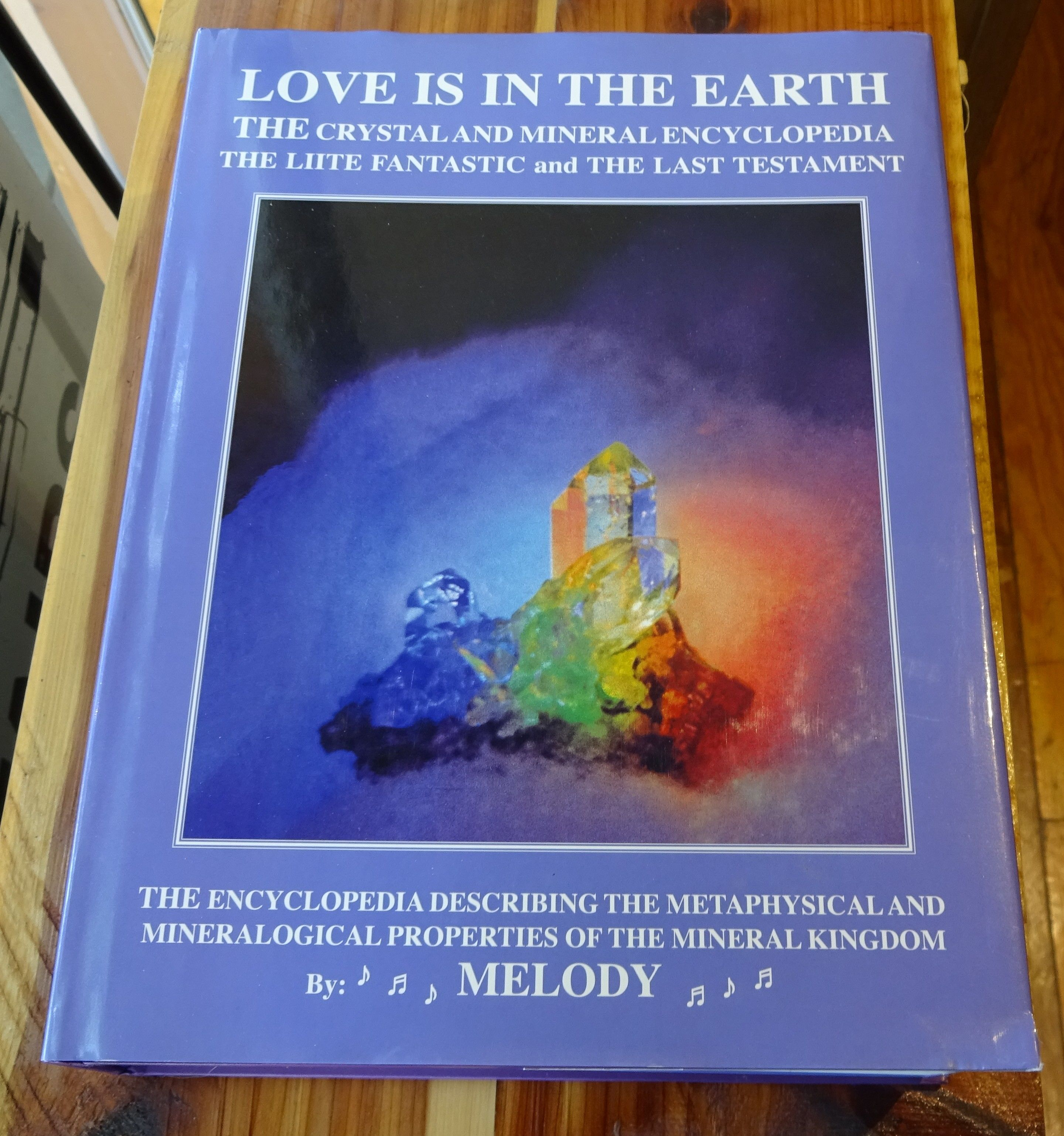 Love Is In The Earth Book