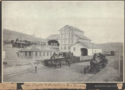 Cripple Creek, CO. Photograph. 13 1/3 x 9 inch letterpress halftone photograph of the Taylor & Brunt...