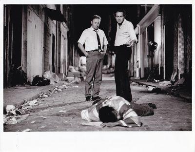 London: Twentieth Century-Fox, 1975. Vintage reference photograph of actor Gene Hackman talking with...