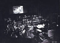 image of The Many Adventures of Winnie the Pooh (Original photograph of Wolfgang Reitherman and Buddy Baker at work on soundtrack, circa 1977)