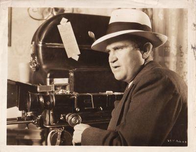 Culver City, CA: RKO Radio Pictures, 1938. Vintage reference photograph of director Eddie Cline behi...