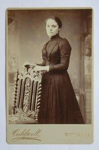 Cabinet Photograph: Portrait of a Young Woman Beside a Chair.