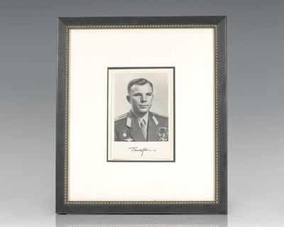 Rare photograph signed by the first human to journey into outer space, Soviet cosmonaut Yuri Gagarin...