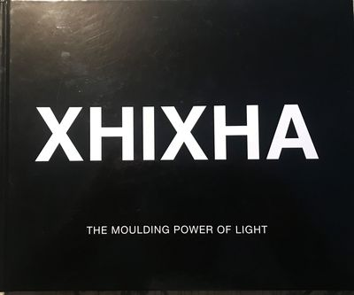 [Miami: The Studio, 2015. First Edition. Signed by Xhixha on the half-title page.