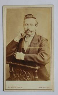 Carte De Visite Photograph. Studio Portrait of a Suited Gentleman with a Moustache.