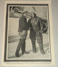 image of A vintage magazine photographic illustration of the IRISH AVIATOR PIONEER JAMES FITZMAURICE, who flew on the first East to West Trans-Atlantic flight, shaking the hand of American aviator FLOYD BENNETT, Byrd's pilot during his expedition to the North Pole who also flew the relief mission to the Bremen aviators.