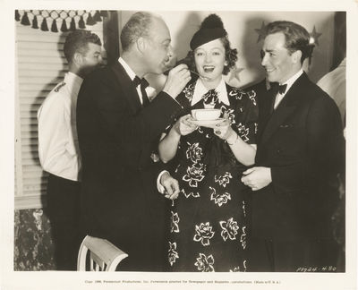 Los Angeles: Paramount Pictures, 1936. Vintage press photograph of Mitchell Leisen, Myrna Loy, and J...