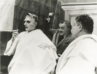N.p.: N.p., 1972. Vintage borderless reference photograph of Federico Fellini demonstrating how to s...