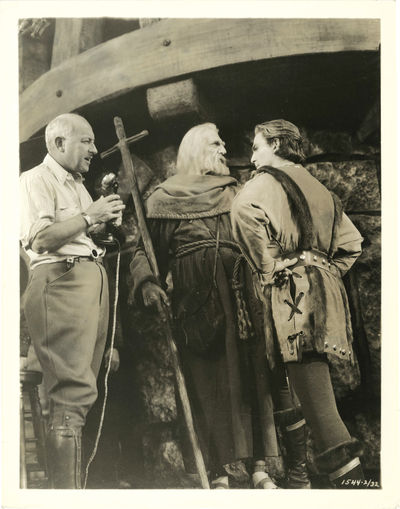 N.p.: N.p., 1935. Two vintage reference photographs of Cecil B. DeMille on the set of the 1935 film,...