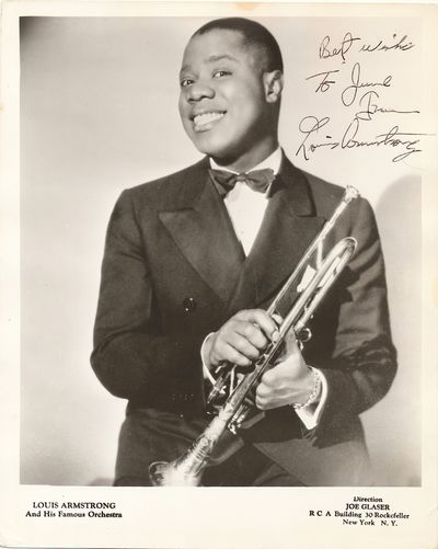 Publicity photograph, silver gelatin print, featuring the great jazz musician holding his trumpet an...