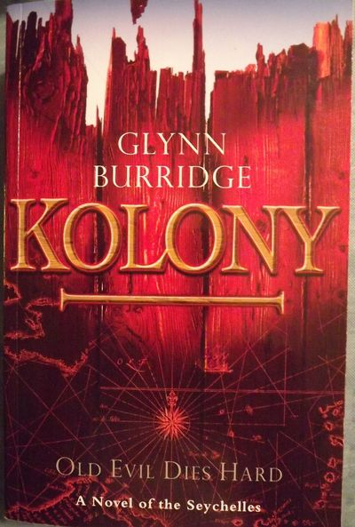 2008. BURRIDGE, Glynn. KOLONY. : Calusa Bay Publications, . 8vo., pictorial wraps; 625 pages. First ...
