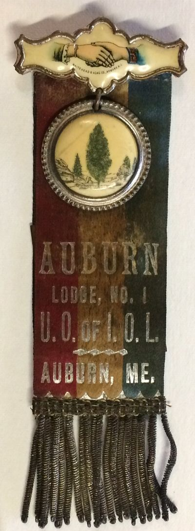 Auburn, ME: the Order; mfg. by Whitehead and Hoag in Newark, NJ, n.d.. Pin with crossed women's hand...