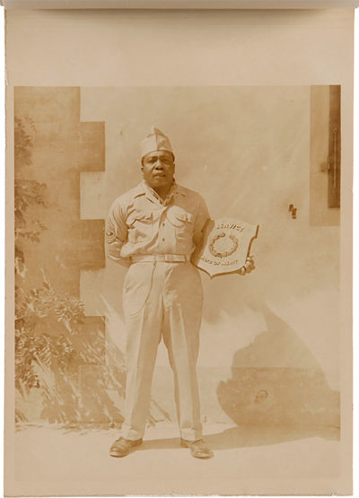 [N.p.: Edward D. Biggerstaff, Jr., 1945. Seventeen sepia-toned photographs, each with captioned tiss...