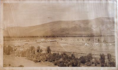 Good. A panoramic photograph of a celebration at Arlee, Montana, circa early 1900s. In shrinkwrap. T...
