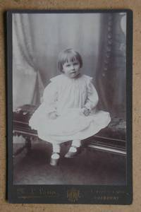 Cabinet Photograph: A Charming Studio Portrait of a Young Child.