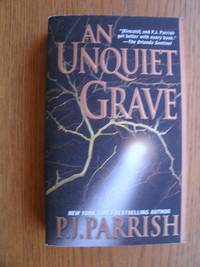 An Unquiet Grave by  P.J Parrish - Paperback - Signed First Edition - 2006 - from Scene of the Crime Books, IOBA (SKU: biblio10081)