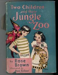 TWO CHILDREN AND THEIR JUNGLE ZOO