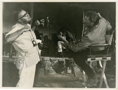 Universal City: Universal Pictures, 1961. Vintage photograph of Robert Aldrich and Kirk Douglas on t...