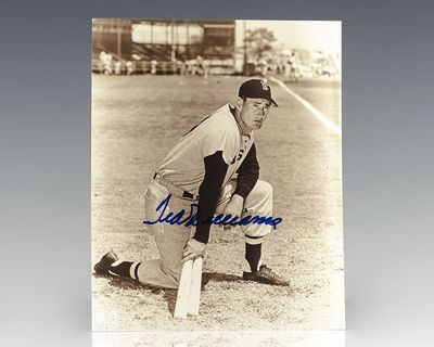 1942. Signed photograph of baseball legend Ted Williams. Boldly signed