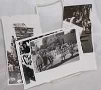 Four b&w photographs of  a Salvadoran march