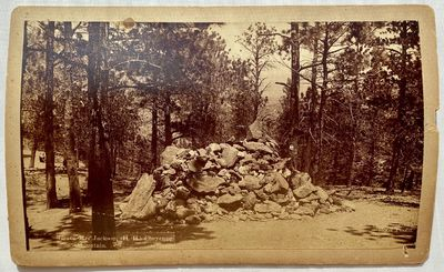 Colorado Springs, CO: W.E. Hook, 1891. Boudoir albumen cabinet card on a cream blind stamped mount H...