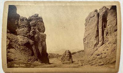 Colorado Springs, CO: W.E. Hook, 1891. Boudoir albumen cabinet card on a cream blind stamped mount H...