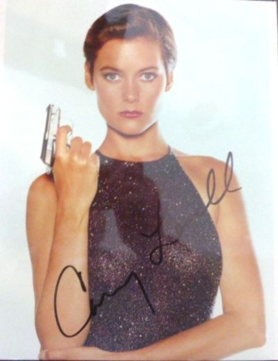 A collection of three signed photographs. All in poses from their roles in James Bond movies. (1) HO...