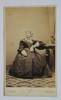 Carte De Visite Photograph: Portrait of a Finely Dressed Lady Holding a Book.