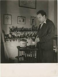image of Original photograph of Arthur Honegger filling his pipe, circa 1940s