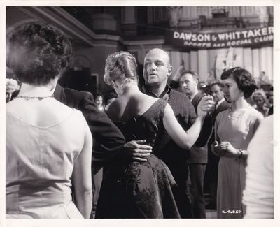 London: Vic Films, 1962. Vintage reference photograph of director John Schlesinger dancing with actr...