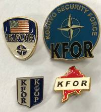 [Four pins from the Kosovo Force (KFOR)]