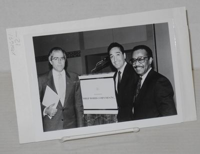 no place: no publisher, no date. Photograph. 5x7 b&w publicity photo of the three subjects at a Medi...