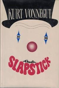 Slapstick by  Kurt Vonnegut - First Delacorte Printing - 1976 - from Bookmarc Books and Biblio.com