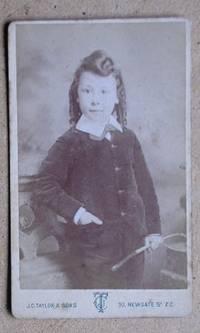 Carte De Visite Photograph. Portrait of a Young Boy Holding a Riding Crop.