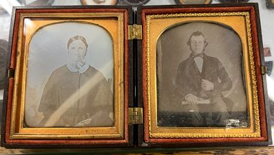 Tintype. Sixth Plate Oval Brown Union Case with duel daguerreotypes of man and woman with geometric ...
