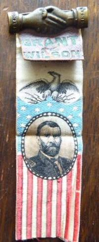 Campaign ribbon with Grant's portrait in oval within American flag. Eagle atop the flag.