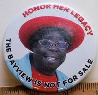 image of Honor Her Legacy; The Bayview is not for Sale [3-inch pinback button with text in red and black on a colorphoto field (activist in a red hat and skyblue coat)]