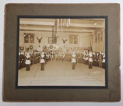 Seattle: Jackson Studio, 1937. 9.25x7.25 inch photo in a larget matte, the backing edgeworn; the pho...