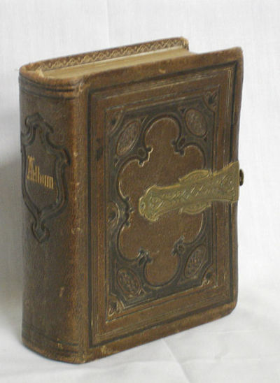 A nice leather album with photographs both carte-de-viste and tintypes featuring an early and scarce...