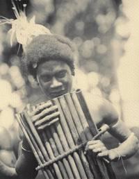 Photograph of a Man Playing Panpipes, 1943, Malaita, Solomon Islands