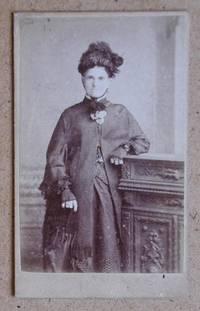 Carte De Visite Photograph. A Studio Portrait of a Finely Dressed Woman Holding a Parasol.