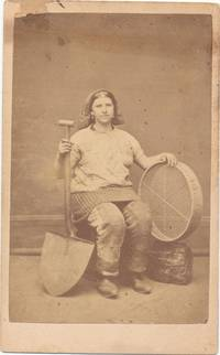 Photograph of Pit Brow Lass in work clothes with tools